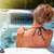 beautiful woman relaxing in hot tub stock photo © kurhan