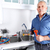 Plumber in kitchen with a wrench. stock photo © Kurhan