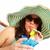 吸引力 · 年輕女子 · 飲用水 · 海灘 · 背面 · 飲料 - 商業照片 © kurhan