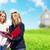 ingatlanügynök · nő · ügyfelek · új · ház · otthon · vásár - stock fotó © kurhan