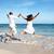 boldog · pár · ugrik · tengerpart · nyári · vakáció · férfi - stock fotó © kurhan