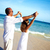 happy couple relaxing on beach stock photo © kurhan