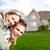 happy family near new house stock photo © kurhan