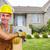 handyman with wood and hammer stock photo © kurhan