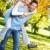 cerca · jóvenes · pareja · amor · hierba · familia - foto stock © kurhan