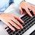 Hands with a computer keyboard. stock photo © Kurhan