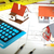 little house and calculator on the table stock photo © kurhan