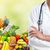 doctor woman near shopping cart with food stock photo © kurhan