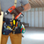 builder handyman with drill and wooden plank stock photo © kurhan