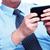 zakenlieden · roepen · smartphone · handen · mensen · die · kantoor - stockfoto © kurhan