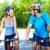 jovens · equitação · bicicletas · floresta · paisagem · casal - foto stock © kurhan