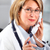 mature doctor woman calling by phone stock photo © kurhan