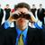 businessman with binoculars stock photo © kurhan