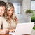 couple with laptop near new house stock photo © kurhan