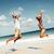 feliz · Pareja · saltar · playa · vacaciones · de · verano · hombre - foto stock © kurhan