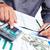 hands of accountant businessman with calculator stock photo © kurhan