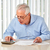 elderly man with papers stock photo © kurhan