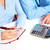 Hands of business person working with calculator. stock photo © Kurhan