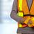 worker with helmet in orange security vest stock photo © kurhan