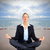 business woman doing yoga on the beach stock photo © kurhan