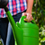 woman in garden with watering can in hand stock photo © kzenon