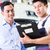 car mechanic and customer in asian auto workshop stock photo © kzenon