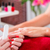 woman at manicure in nail parlor with file stock photo © kzenon