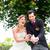 bridal pair with flying white doves at wedding stock photo © kzenon