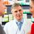 Pharmacist with customers in pharmacy stock photo © Kzenon