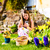 girl on easter egg hunt with living easter bunny stock photo © kzenon