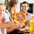 bavarian girl with family in restaurant stock photo © kzenon