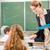 teacher teaching a class of pupils in school stock photo © kzenon