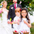 wedding couple and bridesmaid showering flowers stock photo © kzenon