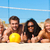 amigos · jogar · praia · voleibol · grupo · mulheres - foto stock © Kzenon