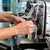 barista in cafe or coffee bar preparing cappuccino stock photo © kzenon