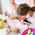 family with mother and kids coloring easter eggs stock photo © kzenon