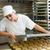 female baker baking bread rolls stock photo © kzenon