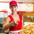 woman holding a whole pizza in hand stock photo © kzenon