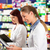 pharmacist with assistant in pharmacy stock photo © kzenon