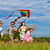 happy family running on meadow with a kite stock photo © kzenon