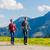 couple doing nordic walking exercise in mountains stock photo © kzenon