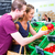 couple selecting vegetables in corner shop stock photo © kzenon