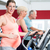 pregnant woman on cross trainer at the gym touches her belly stock photo © kzenon