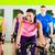 спортзал · инструктор · женщину · улыбаясь · осуществлять · велосипед - Сток-фото © kzenon