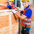 worker close a wood box with hammer and nail stock photo © kzenon