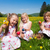 Children on Easter egg hunt with eggs stock photo © Kzenon