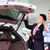 asian man looking at car in dealership stock photo © kzenon
