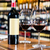 bottle of red wine and two glasses in wine shop stock photo © kzenon