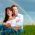 happy couple sitting on a meadow under rainbow stock photo © kzenon