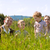famille · quatre · s'asseoir · nuages · herbe · main - photo stock © kzenon